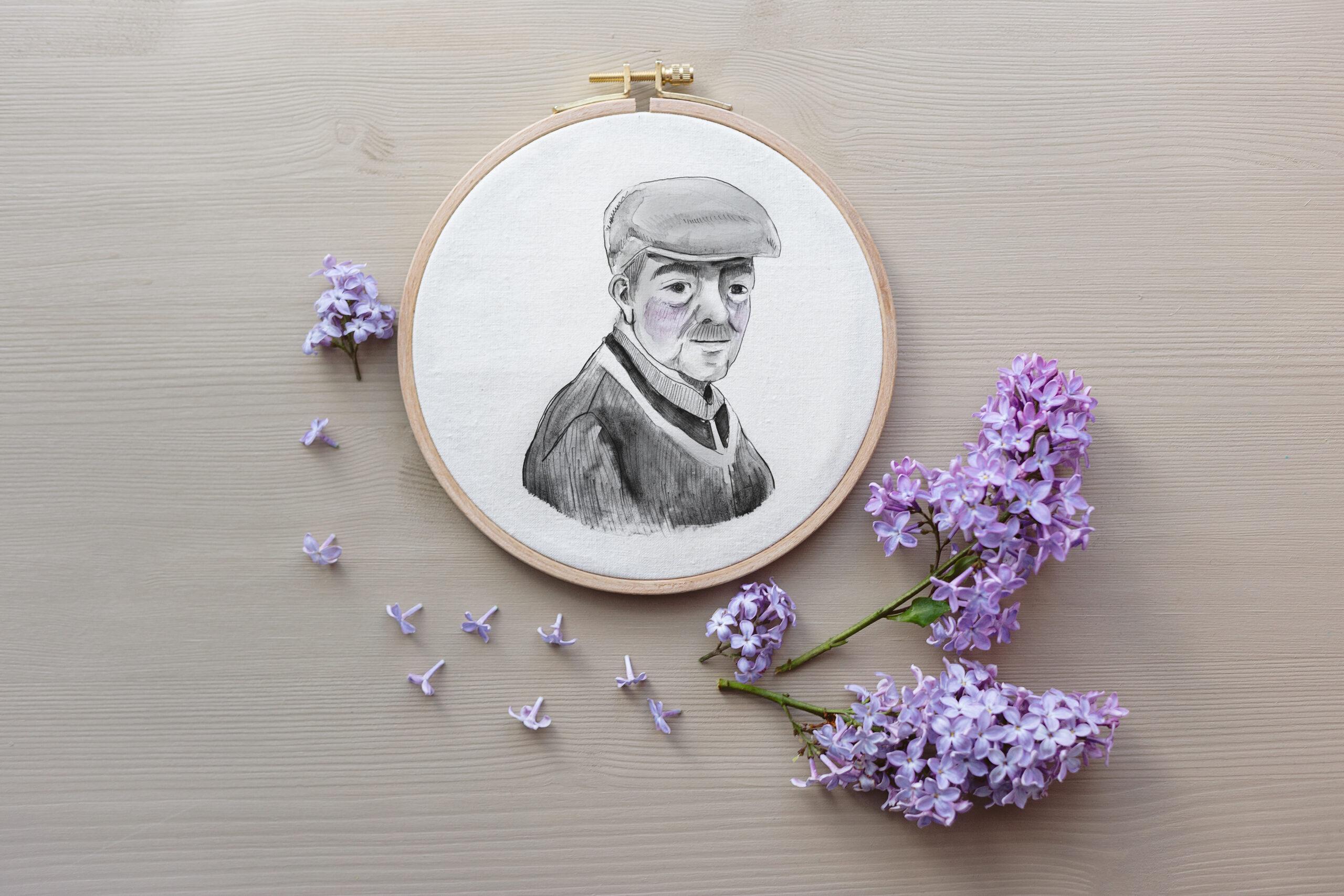 tambor de bordar con retrato de un abuelo con boina estilo dibujo trazos blanco y negro con flores de decoracion